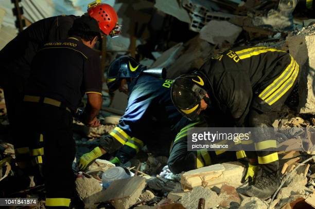 Members of the emergency services search for victims in the rubble in Amatrice, Italy, 24 August 2016. Several people have died as the result of a...