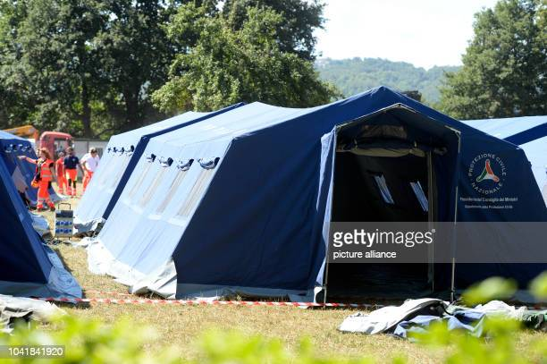 Members of the emergency services set up tents for survivors in Amatrice, Italy, 25 August 2016. Several people have died as the result of a powerful...