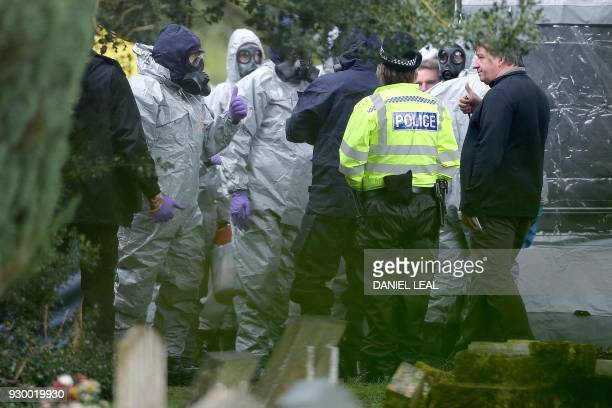 TOPSHOT Members of the emergency services wearing biohazard protective suits work at the London Road Cemetery in Salisbury southern England on March...