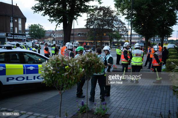 Members of the emergency services work around the entrance to Southgate underground station following reports of an explosion on June 19 2018 in...