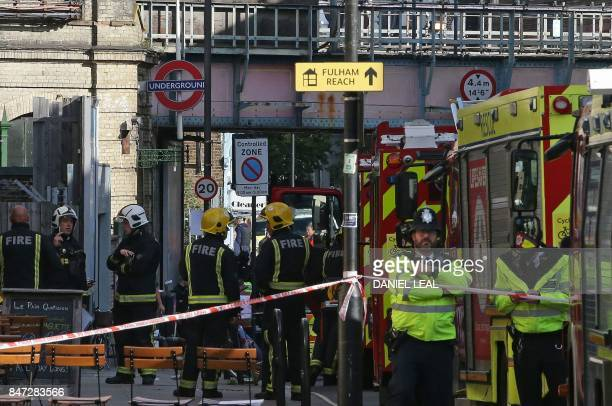 Members of the emergency services work outside Parsons Green underground tube station in west London on September 15 following an incident on an...