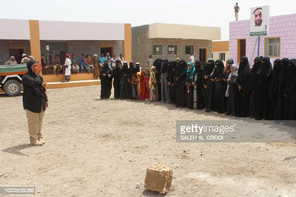 Members of the Emirati armed forces take part in a campaign to raise awareness against mines and IED with locals south of Mocha western Yemen on July...