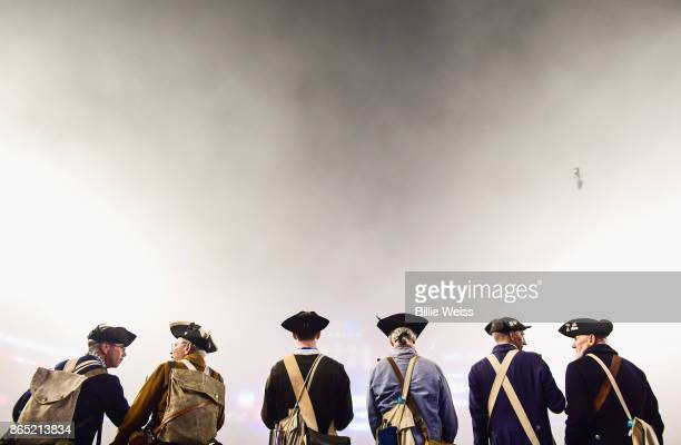 Members of the End Zone Militia look on as fog falls on the field during a game between the New England Patriots and the Atlanta Falcons at Gillette...
