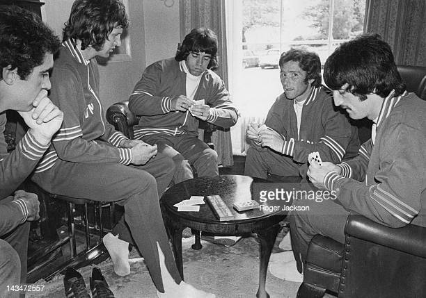 Members of the England football squad playing cards at the team headquarters in Hertfordshire, 23rd May 1975. Left to right: Peter Shilton, Mick...