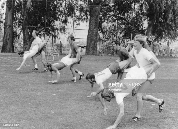 Members of the England football team competing in a wheelbarrow race during fitness training at the World Cup Mexico City May 1970