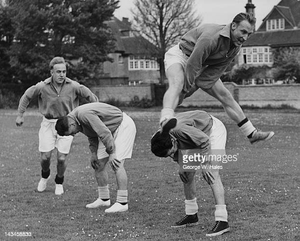 Members of the England football team leapfrogging during a training session at Eastbourne Cricket Ground 13th May 1952 Left to right Captain Billy...