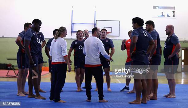 Members of the England rugby team look on as they take part in a judo session led by British Olympians Kate Howey and JP Bell as part of their...
