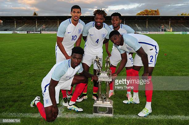 Members of the England side celebrate with the trophy during the Final of the Toulon Tournament between England and France at Parc Des Sports on May...