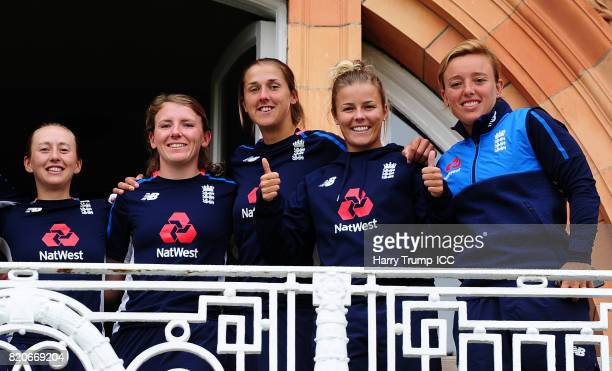 Members of the England side Fran Wilson Beth Langston Jenny Gunn Alex Hartley and Danielle Hazell stand on a balcony during the England v India Final...