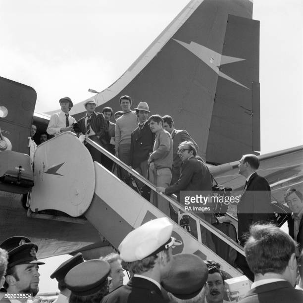 Members of the England team board the plane at Heathrow Airport en route to the World Cup in Mexico Left to right Colin Bell Alan Mullery Tommy...