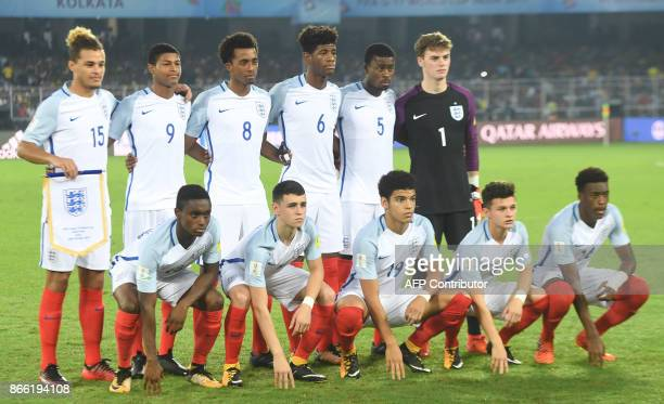 Members of the England team pose for a photograph prior to the start of their semifinal football match against Brazil of the FIFA U17 World Cup at...