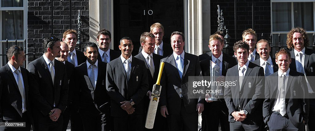 Members of the England Twenty20 Cricket World Cup winning team pose with British Prime Minister David Cameron (centre right) outside 10, Downing Street, after meeting him inside for a reception following their success at the tournament in London, on May 24, 2010. AFP PHOTO Carl Court.