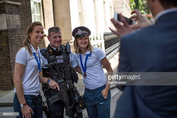 Members of the England Women's Football team Karen Bardsley and Ellen White take pose for a photo with a police officer outside 10 Downing Street on...