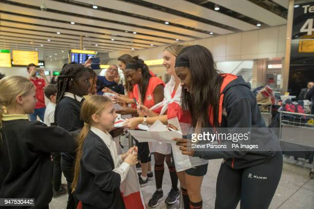 Members of the England women's Netball team which won a gold medal at the Commonwealth Games are greeted by local school children during a Homecoming...