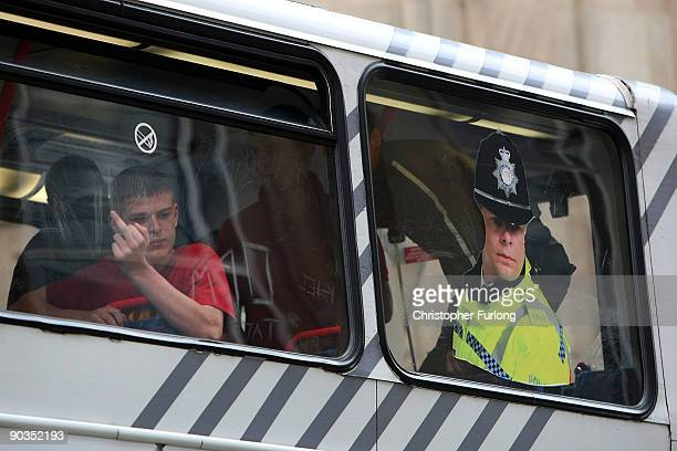 Members of the English Defence League are bussed away from the city center by police Police after clashes with antiright wing protesters during a...