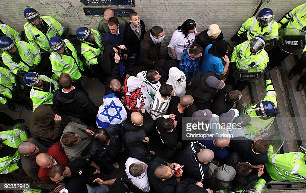 Members of the English Defence League are corralled by police in a subway during a rally on September 5 2009 in Birmingham England The English...