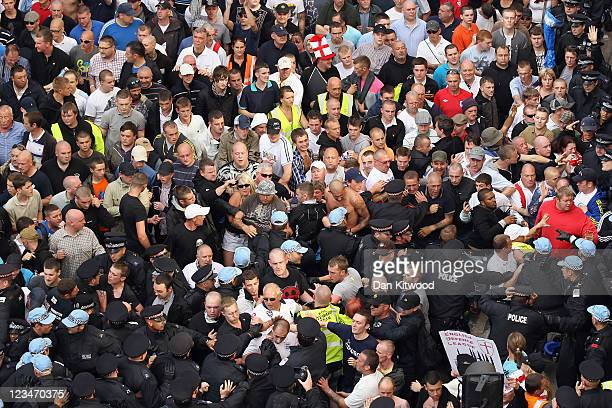 Members of the English Defence League clash with police after a protest on September 3 2011 in London England Members of the EDL held a static...