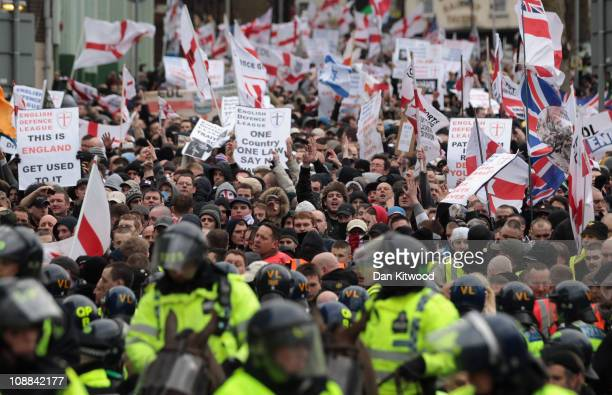 Members of the English Defence League demonstrate in front of police on February 5 2011 in Luton England A counter demonstration was held by the...