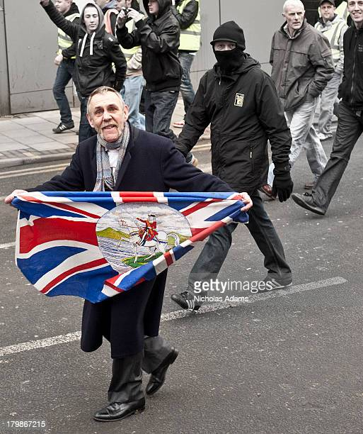 CONTENT] Members of the English Defence League during their march through the streets of Luton