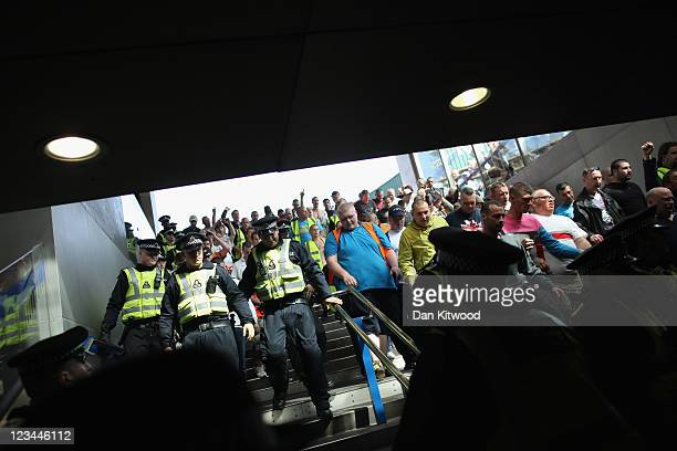 Members of the English Defence League enter the Kings Cross underground station on September 3 2011 in London England Members of the EDL are to hold...