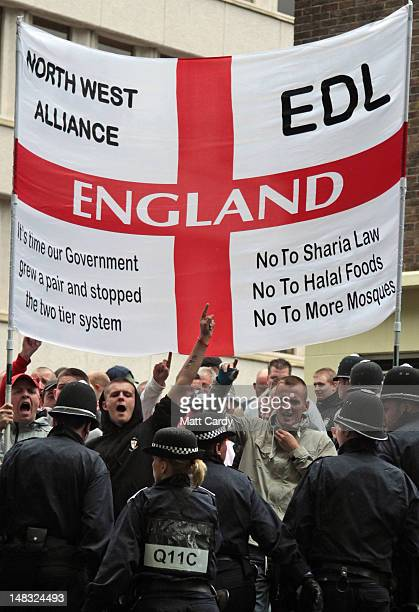 Members of the English Defence League gesture as they march through Bristol on July 14 2012 in Bristol England A large police presence was used to...