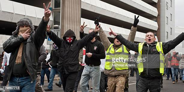 Members of the English Defence League march through the streets of Luton