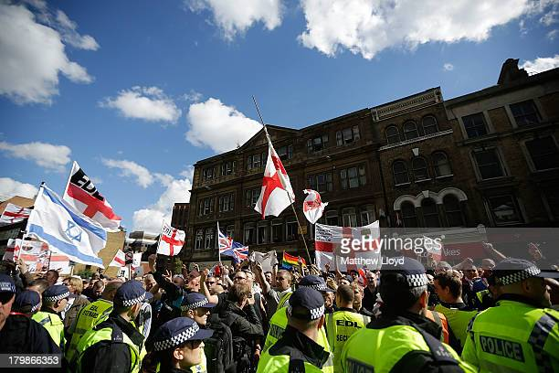 Members of the English Defence League rally for speeches by the farright organisation's leader and deputy leader at Aldgate on September 7 2013 in...