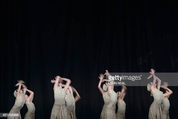 Members of the English National Ballet perform Dust choreographed by Akram Khan from Lest We Forget on the Pyramid Stage on the last day of the...