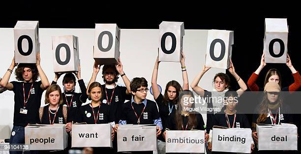 Members of the environmentalist group TckTckTck protest during the first day of United Nations Climate Change Conference on December 7 2009 in...