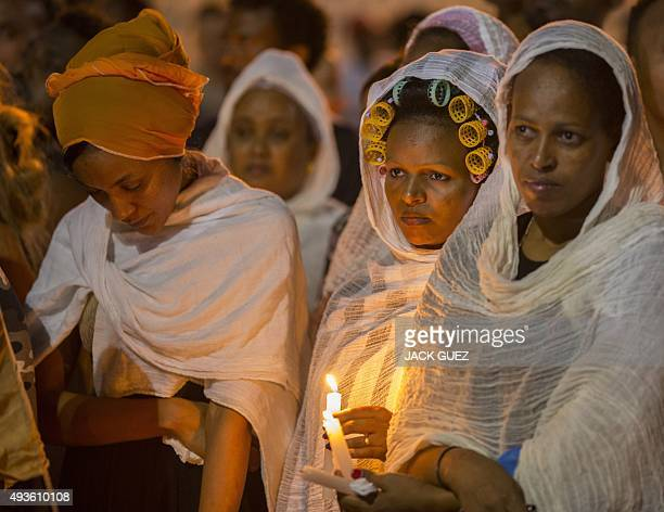 Members of the Eritrean community in Israel attend a memorial ceremony on October 21 2015 in the Israeli city of Tel Aviv for Eritrean asylum seeker...