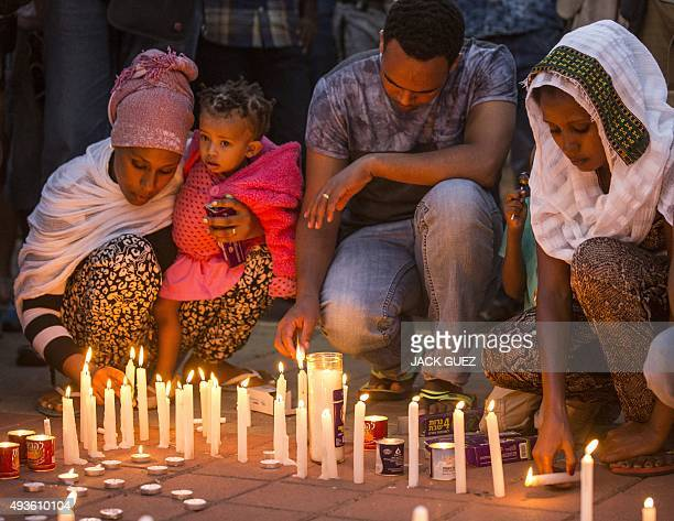 Members of the Eritrean community in Israel light candles on October 21 2015 in the Israeli city of Tel Aviv during a memorial ceremony for Eritrean...
