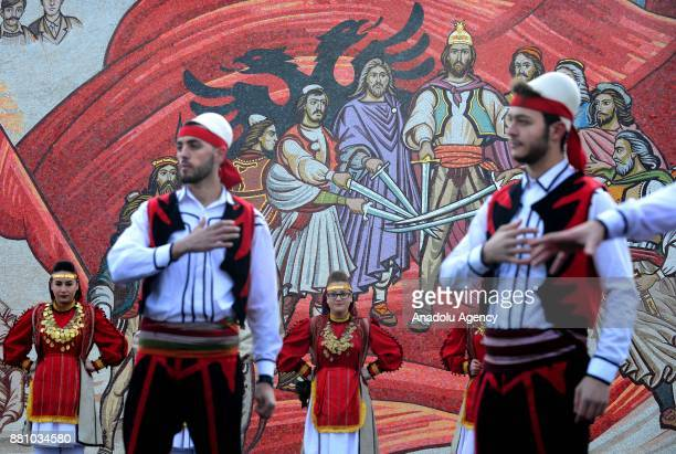 Members of the ethnic Albanian minority in Macedonia with traditional dresses perform traditional dance, as they celebrate the National Albanian Flag...