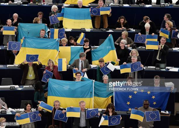 Members of the European Parliament most of them holding an Ukrainian and European Union flags vote in the European Parliament in Strasbourg eastern...