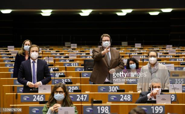 Members of the European Parliament protest against the sessions done in the building and not remotely, during a plenary session of the European...