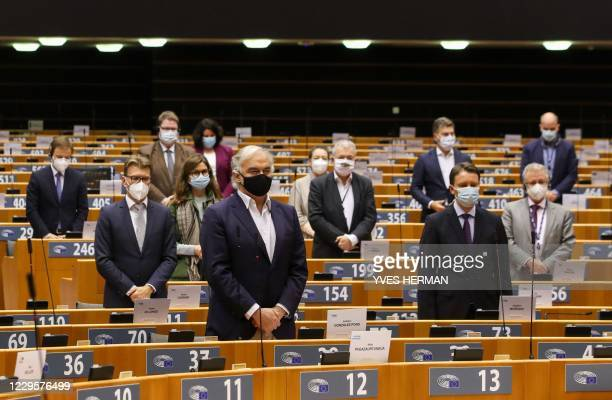 Members of the European Parliament stand up to hold a minute of silence in tribute to the victims of the attacks in Paris and Nice, during a plenary...