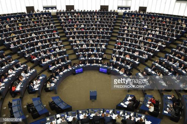 Members of the European Parliament take part in a voting session during a plenary session at the European Parliament on September 12 2018 in...