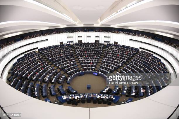 Members of the European Parliament take part in a voting session during a plenary session at the European Parliament on December 11 2018 in...