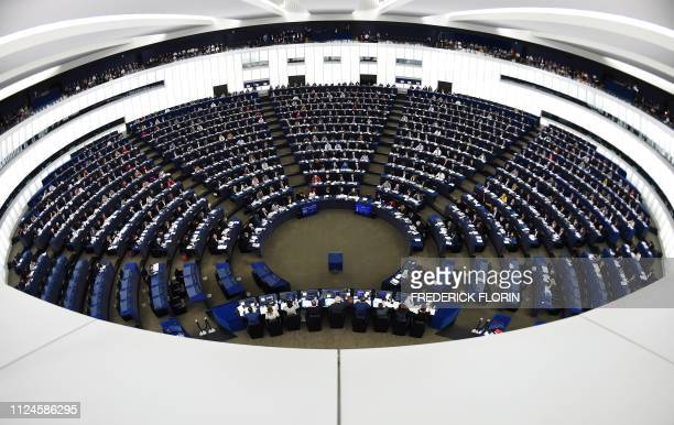 Members of the European Parliament take part in a voting session during a plenary session at the European Parliament on February 13 2019 in...