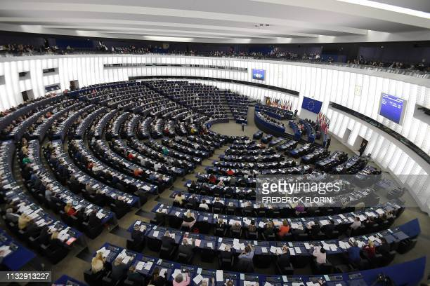 Members of the European Parliament take part in a voting session during a plenary session at the European Parliament on March 26 2019 in Strasbourg...