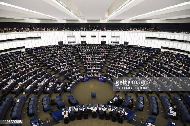 Members of the European Parliament take part in a voting session during a plenary session at the European Parliament on July 18, 2019 in Strasbourg,...