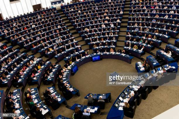 Members of the European Parliament take part in a voting session during the third day of the European Parliament's plenary session at the European...