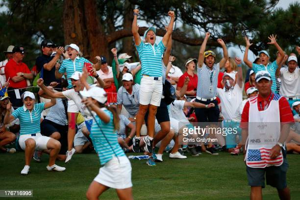 Members of the European Team celebrate after Karine Icher of France made a putt on the 18th hole to win their match by one hole during the afternoon...