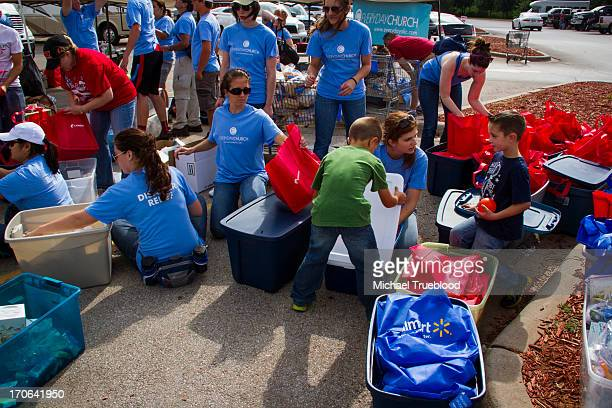 CONTENT] Members of the Everyday Church help with the recovery in Moore Oklahoma The workers put together packages of food water and supplies for the...