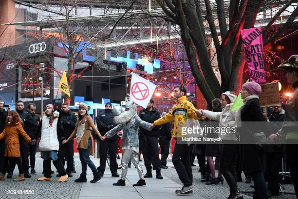 Members of the Extinction Rebellion climate action group stage a protest ahead the closing ceremony of the 70th Berlinale International Film Festival...