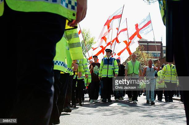 Members of the extreme rightwing group the National Front hold their St Georges Day Parade April 24 2004 in London