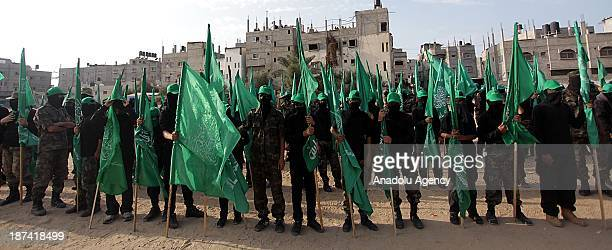 Members of the Ezzeddin al-Qassam, the military wing of Hamas, attend an anti-Israel protest on the first anniversary of Israel's Operation Pillar of...