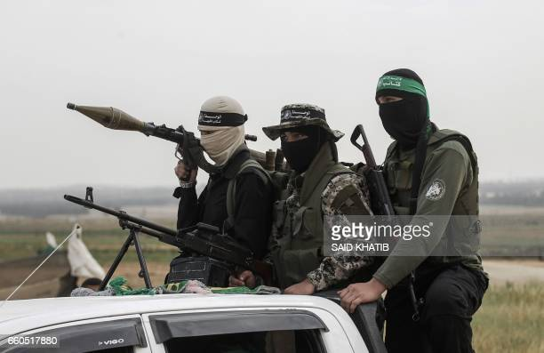 Members of the Ezzedine alQassam Brigades the militant wing of the Palestinian Islamist movement Hamas patrol during a rally to mark Land Day near...