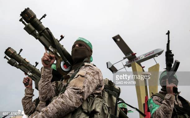 TOPSHOT Members of the Ezzedine alQassam Brigades the military wing of the Palestinian Islamist movement Hamas attend a memorial in the southern Gaza...