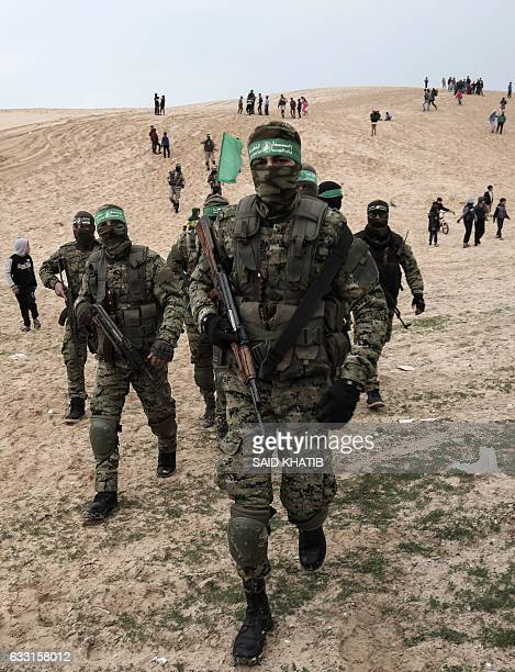 Members of the Ezzedine alQassam Brigades the military wing of the Palestinian Islamist movement Hamas attend a memorial in the southern Gaza aStrip...