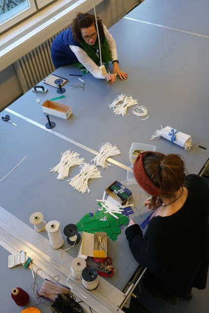 DEU: Berlin Fashion School Produces Surgical Masks During Coronavirus Crisis.